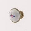 Úchytka CASTELO kulatá - kombinace kov + porcelán